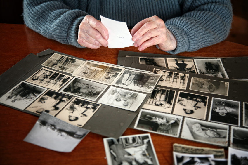 a photo of a woman looking at photographs.